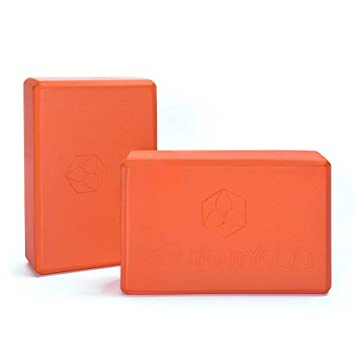 2x bloques de yoga »Aruna« / Bloque de yoga de espuma dura muy ligero, para ejercer como apoyo en determinados ejercicios de yoga / Naranja