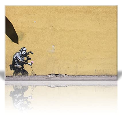 Amazon.com: Wall26 - Canvas Print Wall Art - Camera man pulls flower ...
