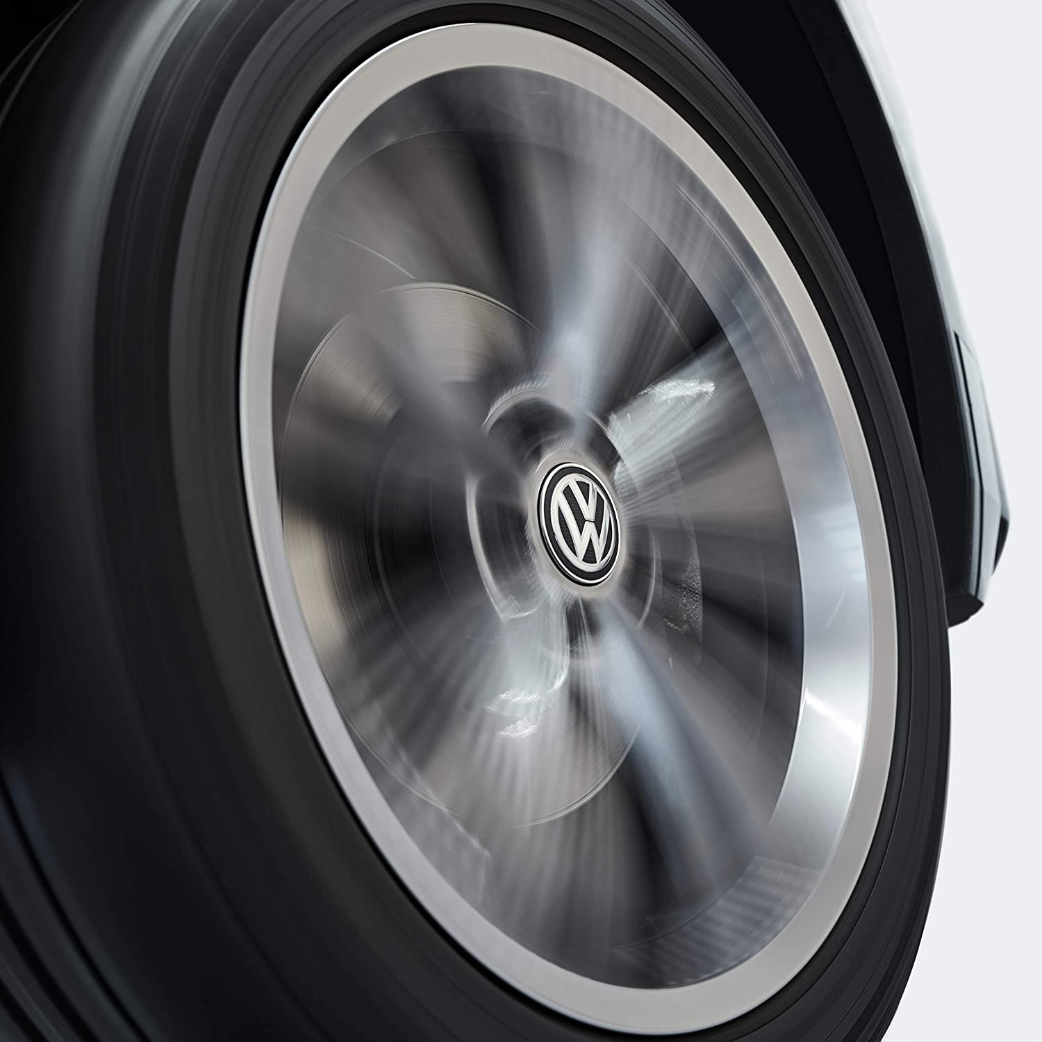 Volkswagen 000071213C Dynamical Hub Cap for LM Rims with Standing Logo in Driving Operation