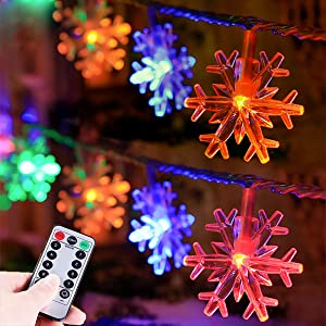 HUGSVIK 25Ft 50 LED Snowflake Christmas Lights Battery Operated, Mulitcolor Changing Snowflake Christmas Tree Lights with Timer, Christmas Snowflake Lights for Christmas Wedding Bedroom Room Patio