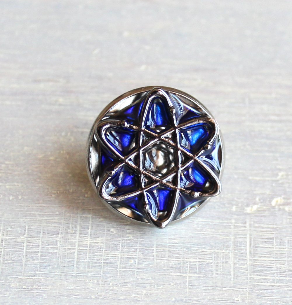 Royal blue atom tie tack.
