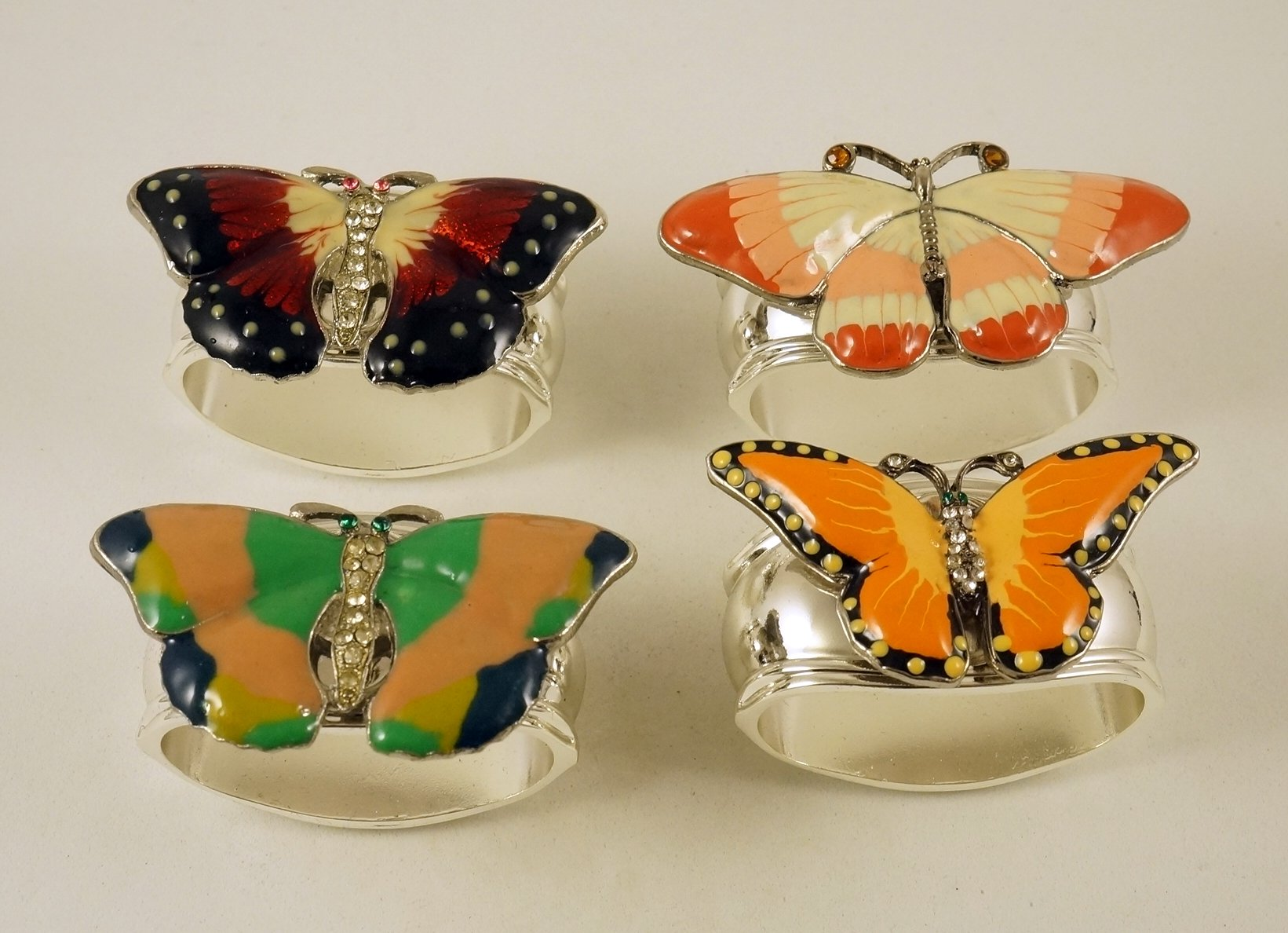 Hans Turnwald Set of Four Silver Plated Napkin Rings with Colorful Jeweled Butterflies