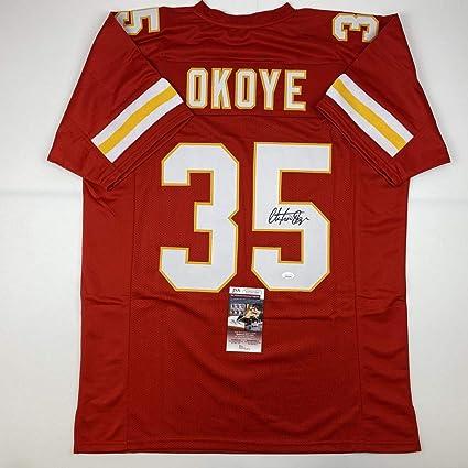 Autographed/Signed Christian Okoye Kansas City Red Football Jersey JSA COA