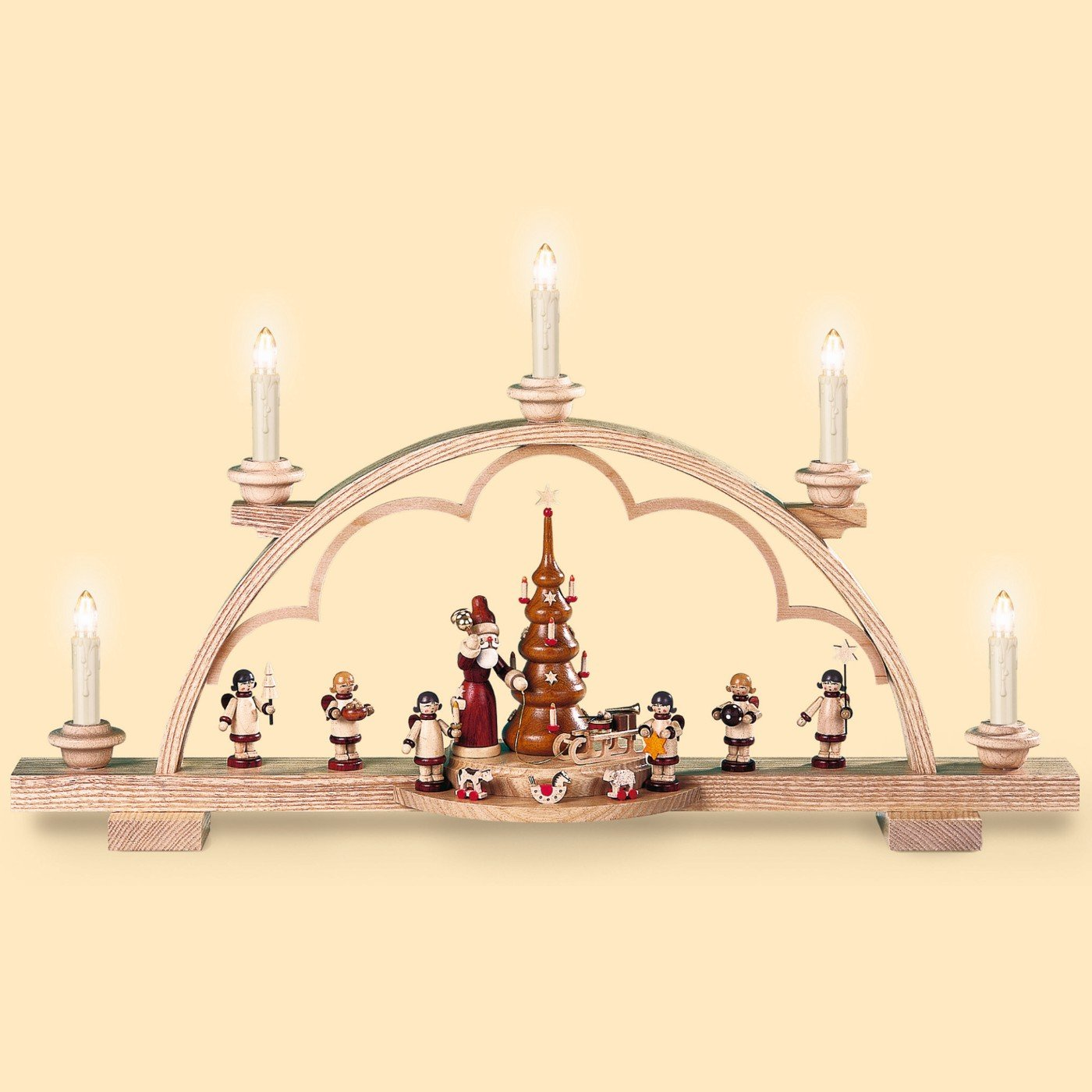 German candle arch Santa giving out Christmas presents, length 57 cm / 22 inch, natural, electrical illuminated (230V, 50Hz), original Erzgebirge by Mueller Seiffen