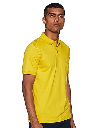 Calvin Klein - Polo Amarillo con Logotipo Blanco: Amazon.es: Ropa ...