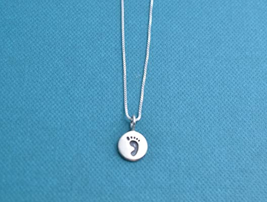 Baby footprint necklace in sterling silver on an 18