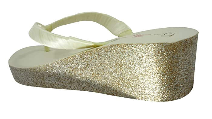 773312acfed1 Amazon.com  Ivory Wedge Flip Flops. Gold Glitter Heel Sandals. Bride Bling