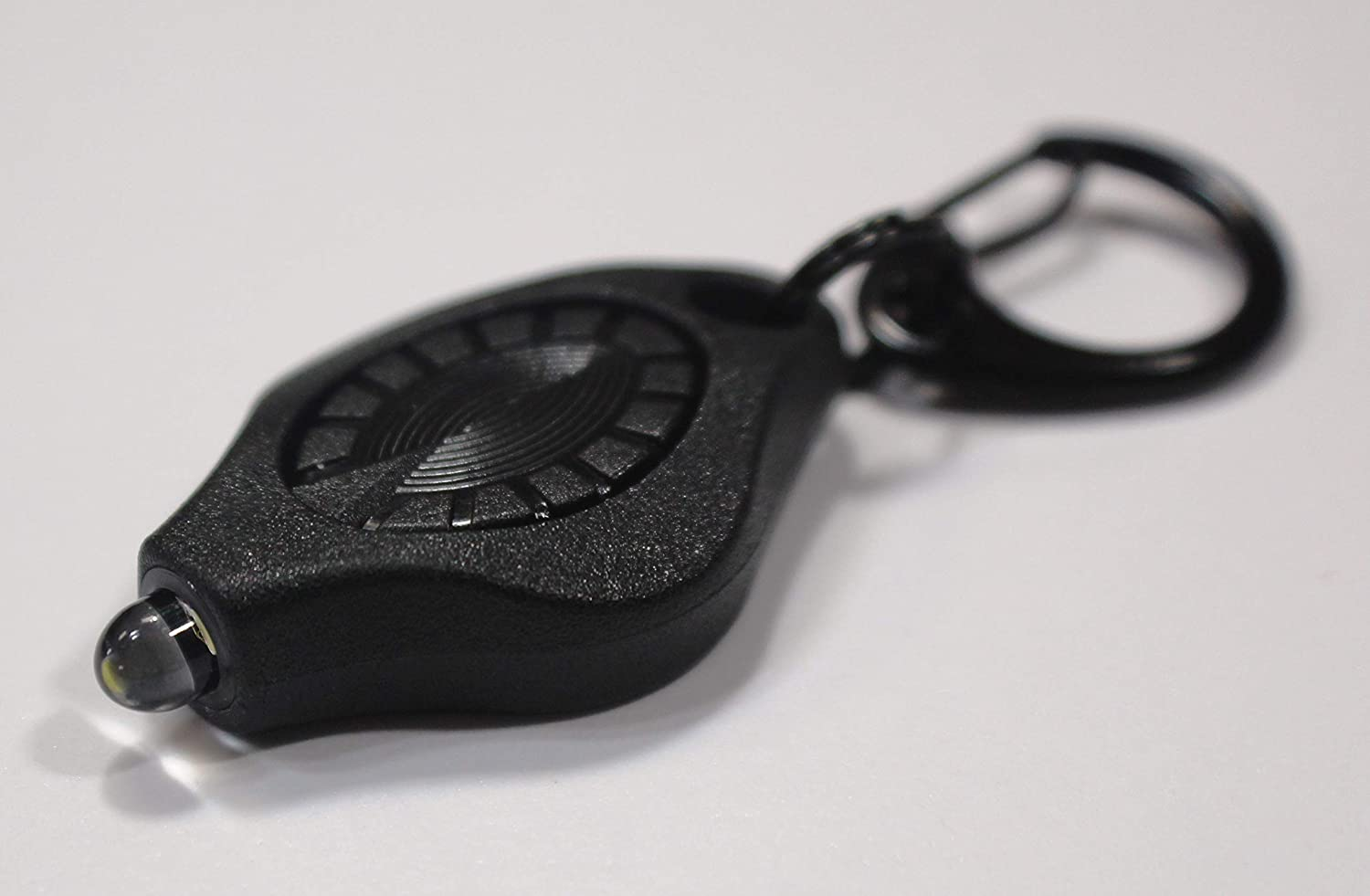 Image of a black keychain flashlight with black keyholder attached to it.
