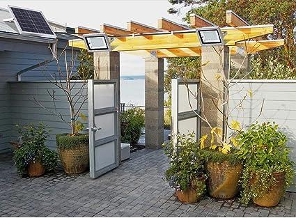 Foco Led Solar Exterior, luz de seguridad con paneles solares,iluminación solar a prueba de agua IP66 con control remoto for garaje, piscina, calle, letrero, cartelera (Color : 100LED): Amazon.es: Iluminación