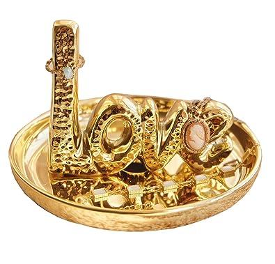 895e4932e58b Cinco cuatro lujosos anillos de oro con soporte para anillos ...