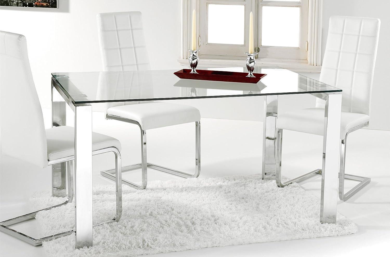 Elegante mesa de comedor con líneas rectas, estructura metálica y buenos acabados.