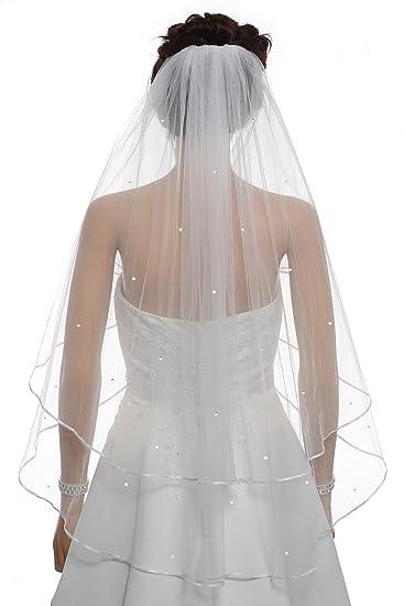 2f6042975 Un velo de novia disponible en colores blanco y marfil. Este modelo tiene  72 pulgadas de ancho con dos medidas de ancho