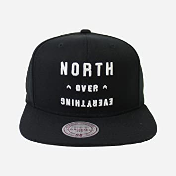 997a96fa4a3 Toronto Raptors North Over Everything Snapback Mitchell   Ness Cap - White    Black