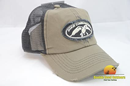 Amazon.com  DUCK COMMANDER Men s Olive and Black Trucker Hat  Sports ... 59bed1c6196