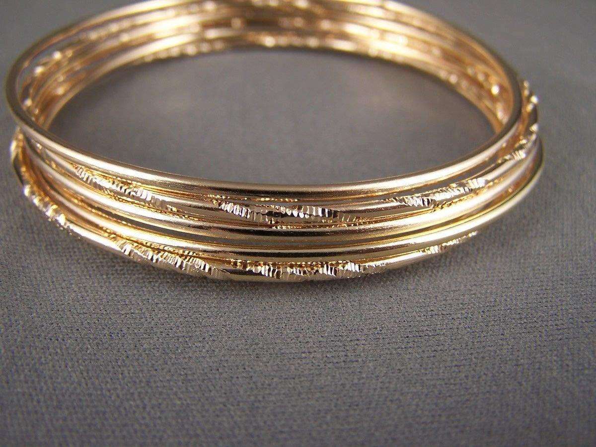 90734e7dfb1 Amazon.com : Gold tone set pack of 7 metal thin skinny bangle bracelet  shiny 2.75 wide : Beauty