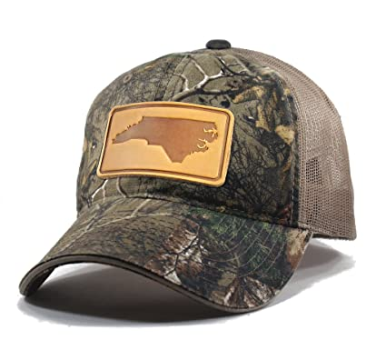 Homeland Tees Men s North Carolina Leather Patch Camo Trucker Hat - Realtree 5a9c863a572
