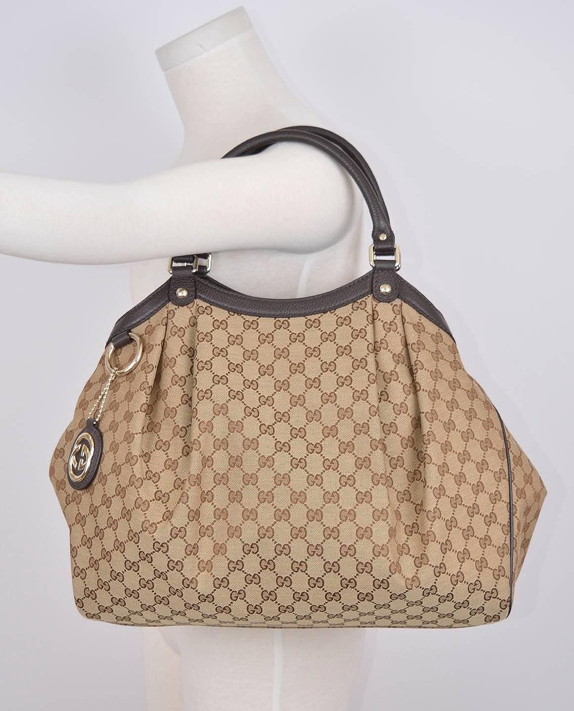 5d03a0c3046 Amazon.com  Gucci Women s Large Brown Canvas GG Guccissima Sukey Hobo  Handbag  Shoes
