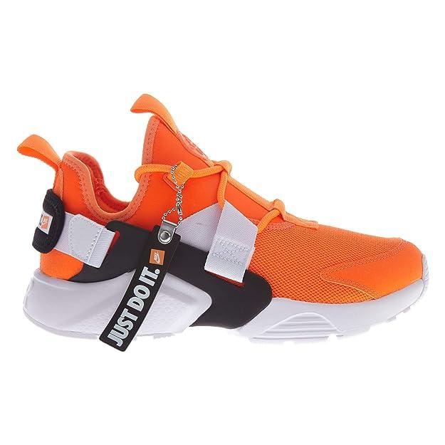 official photos 142df 965db Amazon.com   Nike Air Huarache City Low PRM Womens   Fashion Sneakers