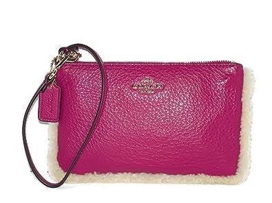 5aa1bb171011 Coach Shearling Cranberry Leather Wristlet 64709  Handbags  Amazon.com