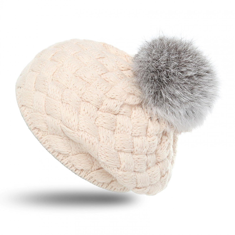 CASPAR Kindermütze klassische Winter Mütze / Angoramütze /Bommelmütze / Strickmütze mit schönem Strickmuster und großem Bommel - beige und rosa - MU119
