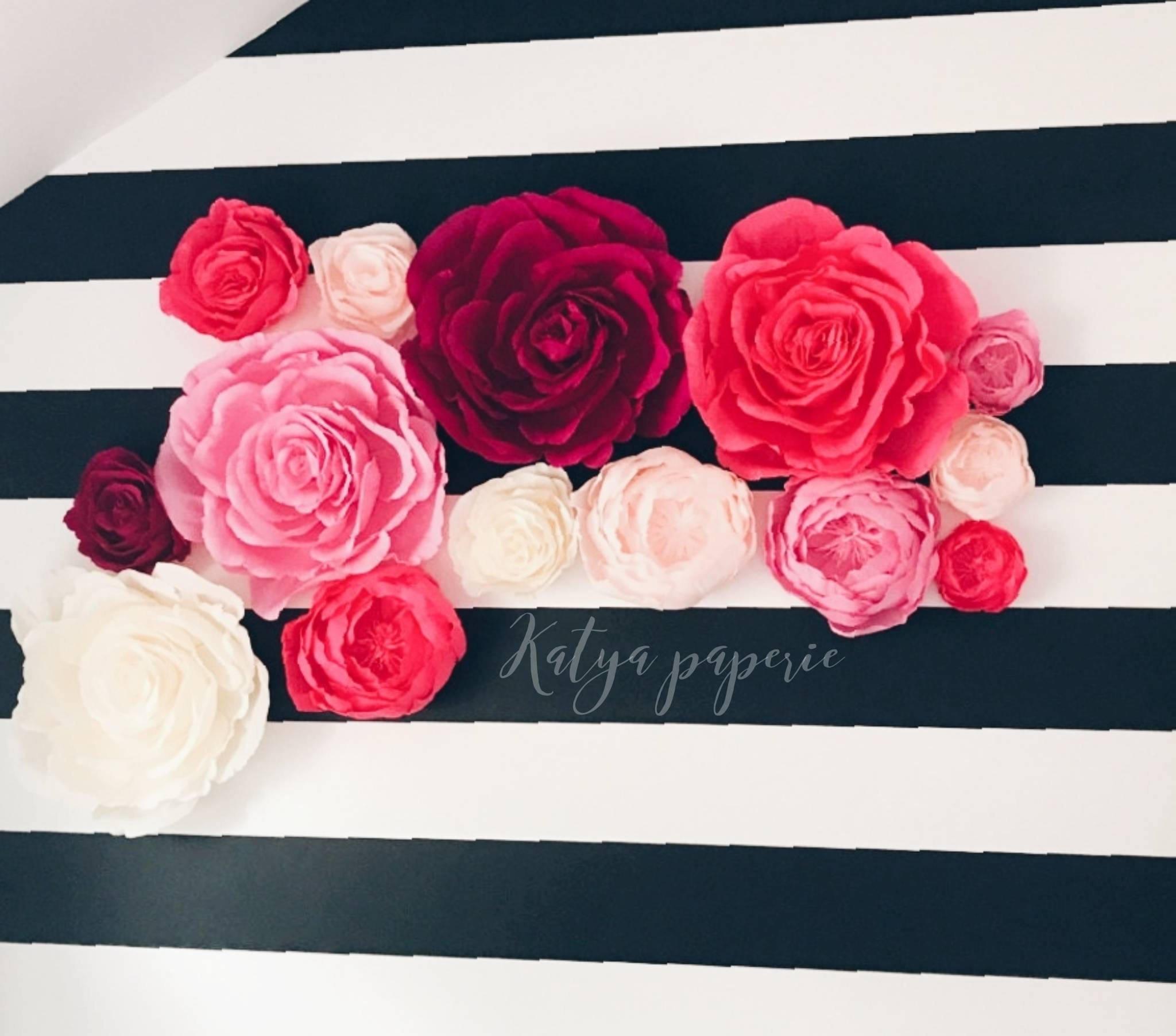 Chic nursery wall paper flowers. Paper flower wall display. Shop window crepe paper flowers. Alice in Wonderland garden party decor