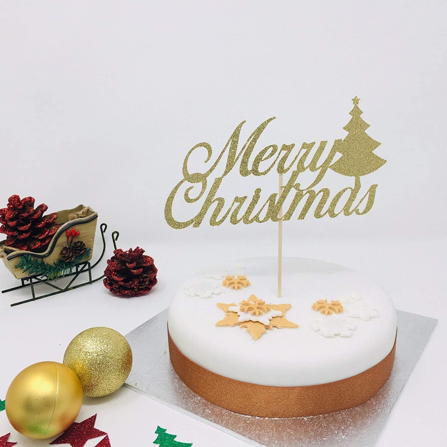 Merry Christmas cake topper with Christmas tree. Christmas cake decoration with glitter topper. Christmas table decorations.