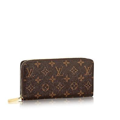 7a071d27574b Louis Vuitton Monogram Canvas Fucsia Zippy Wallet M41895  Handbags   Amazon.com