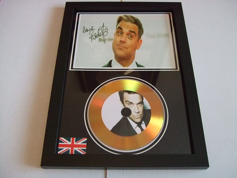 Disque dor sign/é Robbie Williams.
