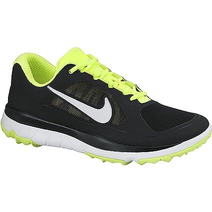 f29891a19c8d Amazon.com  Nike Men s FI Impact Black Volt White Golf Shoes Black ...