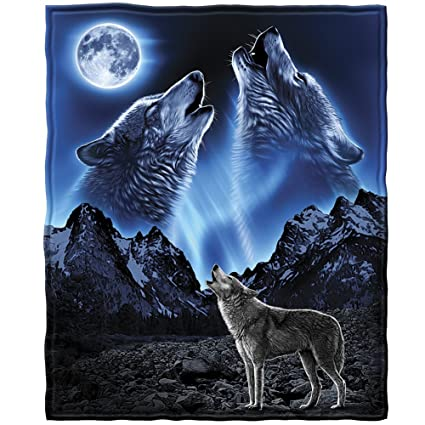 Pictures of a wolf howling at the moon