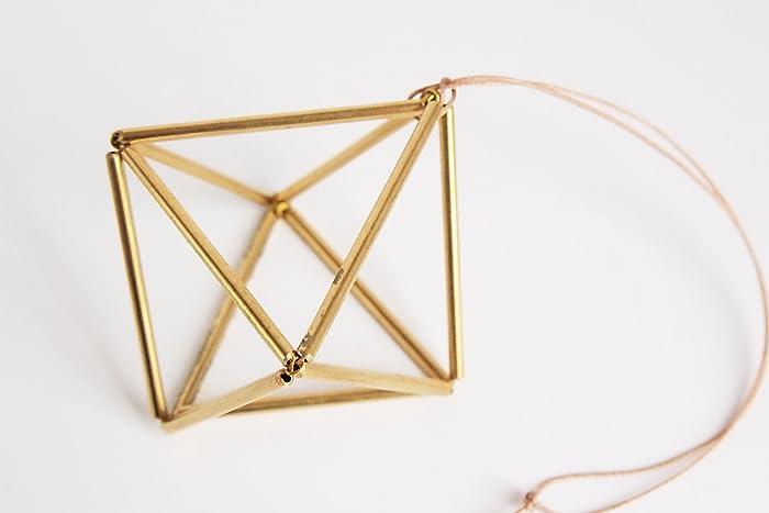 Scandinavian geometric ornament handmade in paris by a real finn