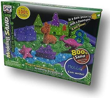 Arena mágica fosforescente para modelar. 800 gr. 2 Colores. con 16 moldes de Castillos, Torres y murallas. Incluye Pala, rastrillo y Bandeja de Juego Hinchable.