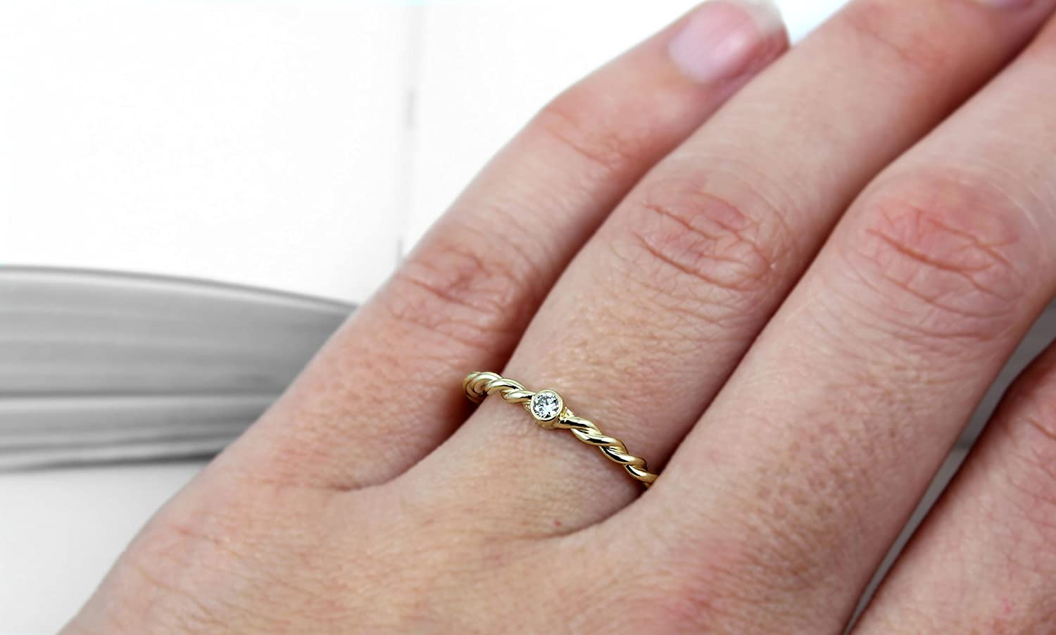 Amazon.com: Conflict Free Diamond Twisted Band Ring - 14k Yellow ...