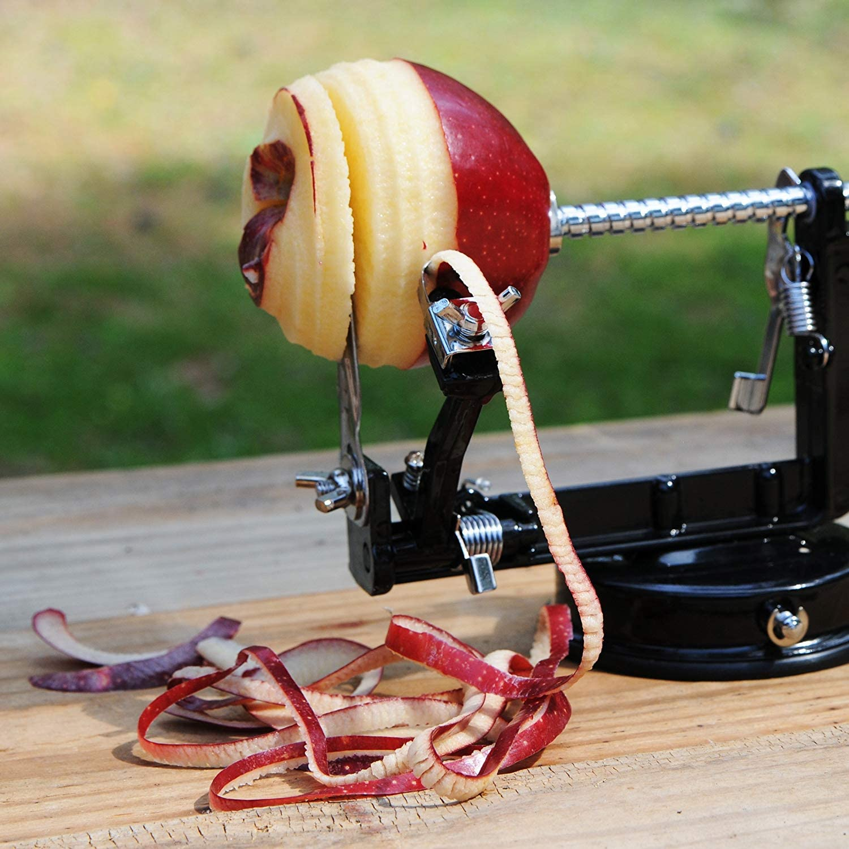 Pelador de manzanas y papas cuchilla de acero inoxidable Adaptaci/ón /óptima a todos los contornos de los alimentos gracias a la cuchilla particularmente ancha,Pelado a la perfecci/ón