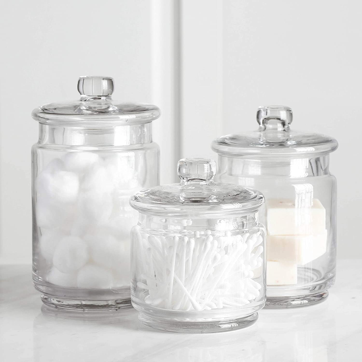 Amazon Com Whole Housewares Clear Glass Apothecary Jars Cotton Jar Bathroom Storage Organizer Canisters Set Of 3 Home Kitchen