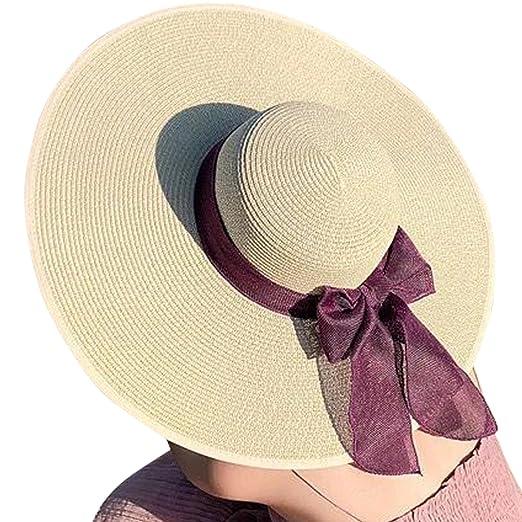 Lanzom Womens Wide Brim Big Bowknot Straw Hat Summer Beach Cap Foldable  Roll up Sun Hat 574cc0988124