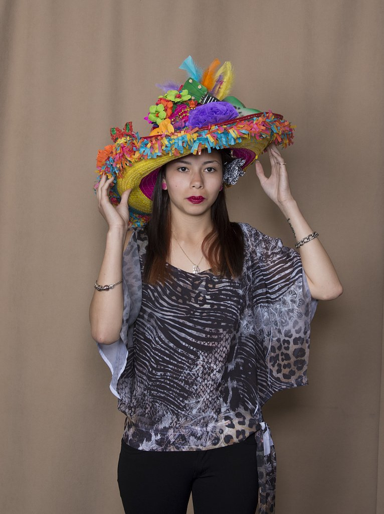 24 x 36 Giclee Print of Isabel Espinoza a Student at The The Academy of Careers and Technologies Charter School in San Antonio Texas Models her Creation exhibited in The Hats Off to Fiesta! Even