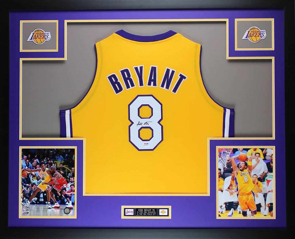 Kobe Bryant Autographed Gold Lakers Jersey - Beautifully Matted and Framed - Hand Signed By Kobe Bryant and Certified Authentic by PSA COA - Includes Certificate of Authenticity SportsFrames.com