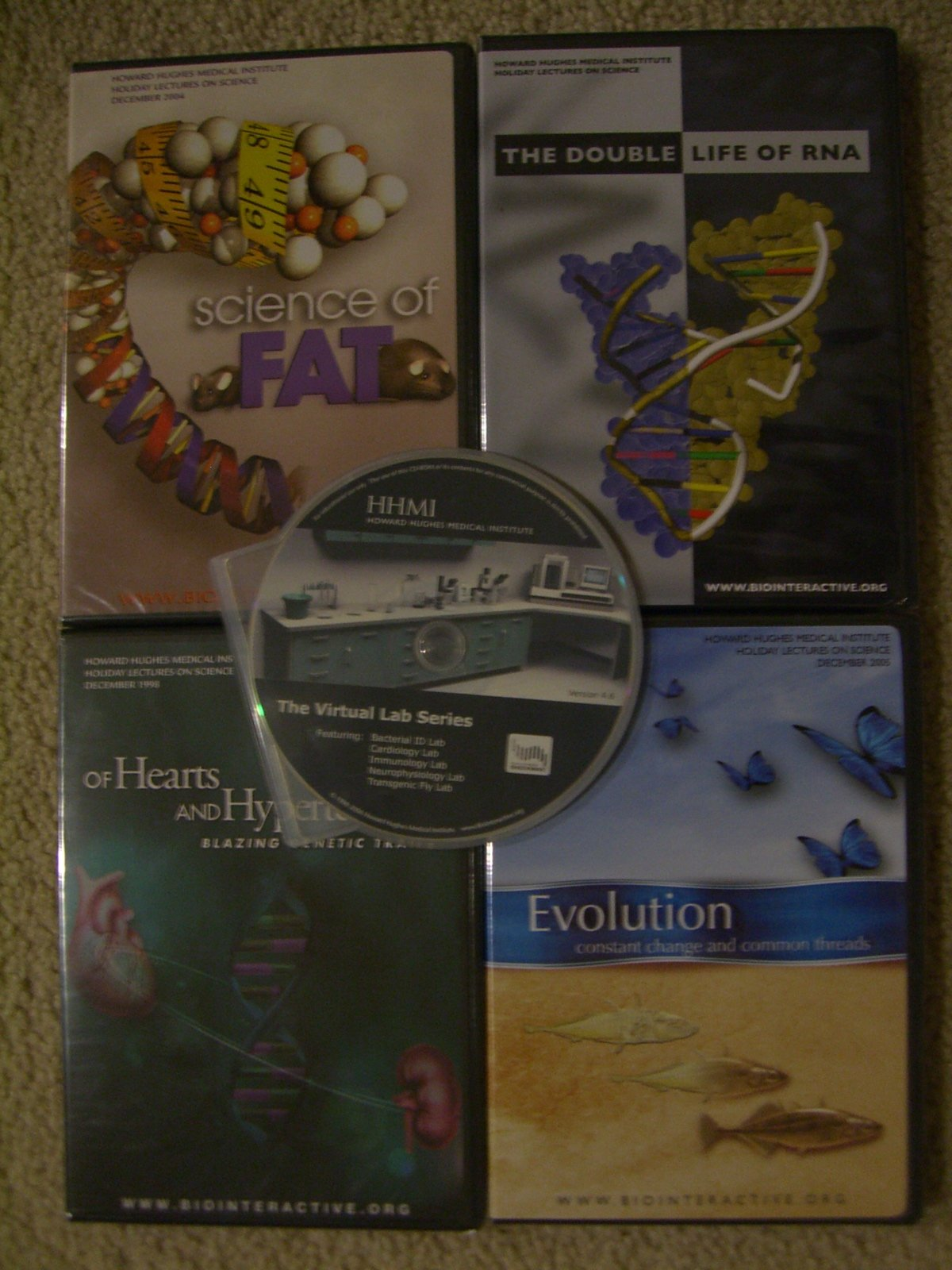 Evolution Constant Change and Common Threads Dvd, Science of FAT Dvd, the Double Life of Rna Dvd, and of Hearts and Hypertension Blazing Genetic Trails Dvd, and the Virtual Lab Series Cd. Set of 4 DVD and One Cd Rom. PDF ePub fb2 ebook