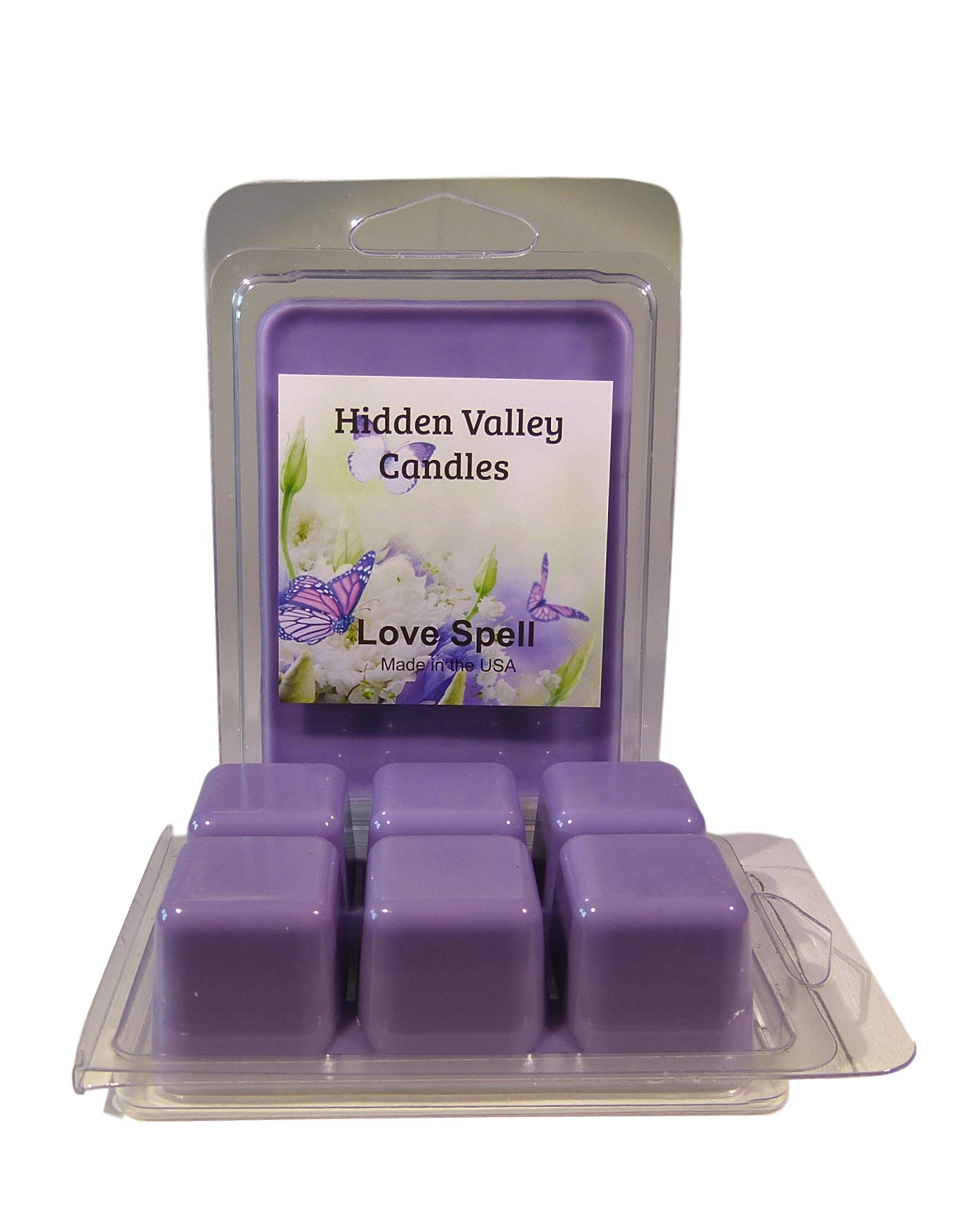 Love Spell ***2 Pack*** Double Scented Wax Melts (6.5oz). An instant classic - this fragrance is a luscious fusion of citrus, cherry blossom, hydrangea, apple and peach; with a hint of blondewood. You will receive 2 packs for a total 12 cubes which will t