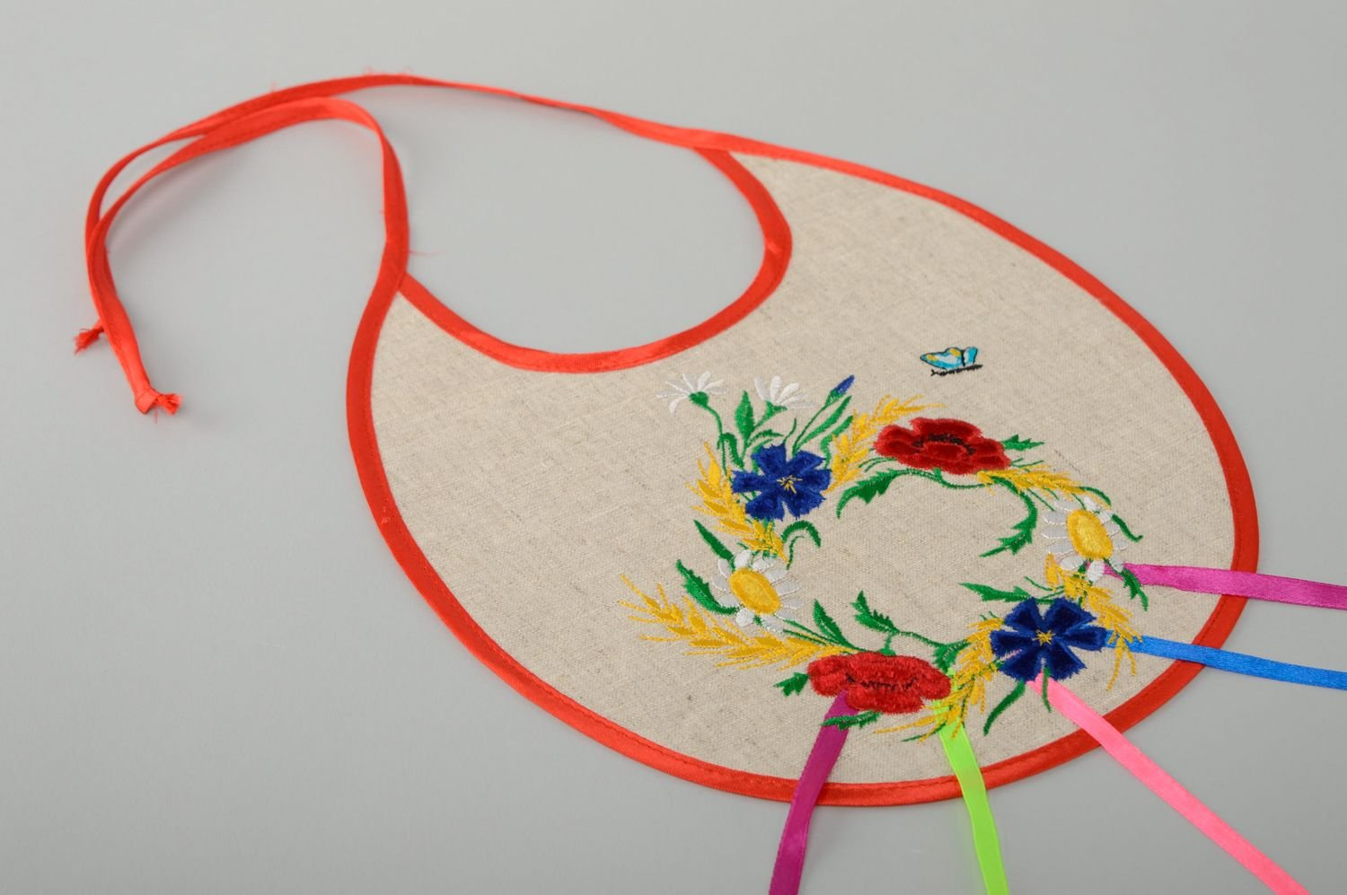 Amazon handmade fabric bib with applique work and embroidery