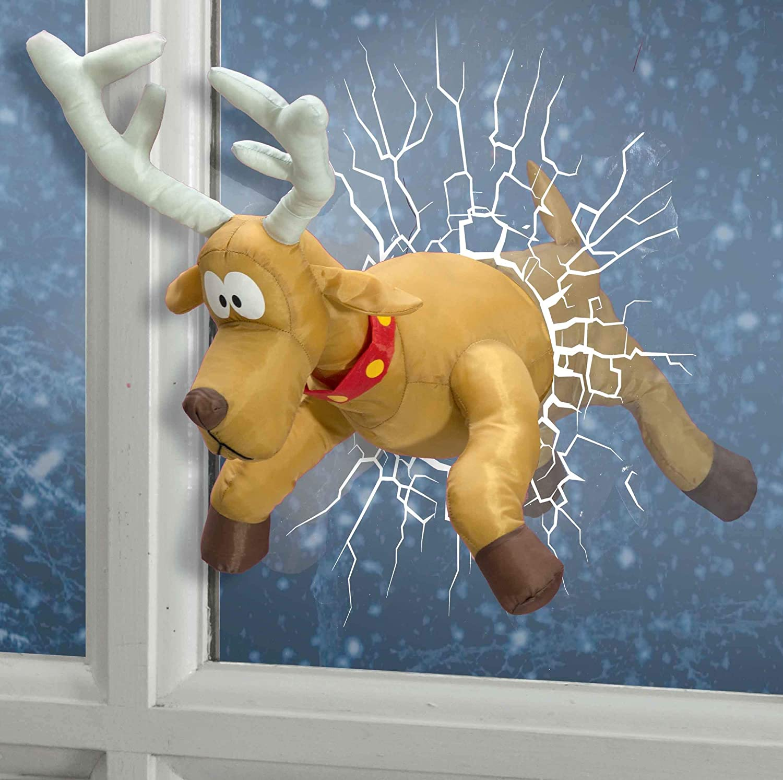 UK Christmas World Decorazione Natalizia a Forma di Renna Che rompe Attraverso Una Finestra.
