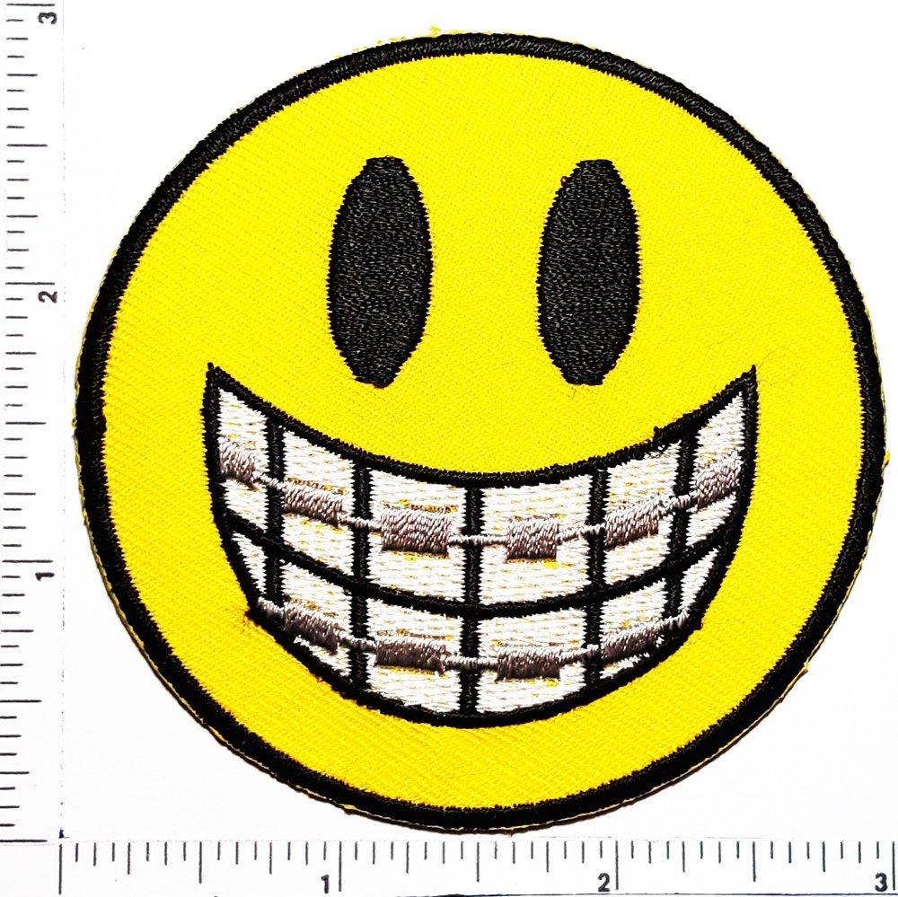 Amazon.com: grimacing dientes Emoji Cara Sonrisa cara logo ...
