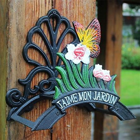 Soporte de pared de riego Tubería de agua sostiene el estante Jardín antiguo Patio decorativo de hierro fundido Manguera Gancho Mariposa Pared Manguera Carrete con cartel de bienvenida Decoracion jard: Amazon.es: Hogar