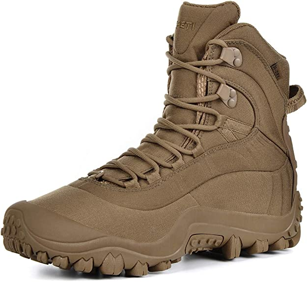 Image of a boot in tan shade, laces looped in place, shoe tongue sticking out.
