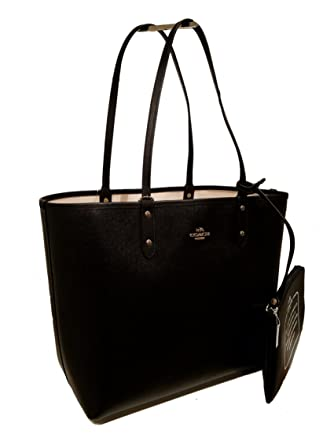 0a36ea65b4 Amazon.com  Coach F36609 Reversible PVC City Tote In Signature Black Chalk   Clothing