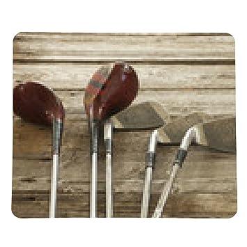 alfombrilla de ratón palos de golf de edad en la superficie ...