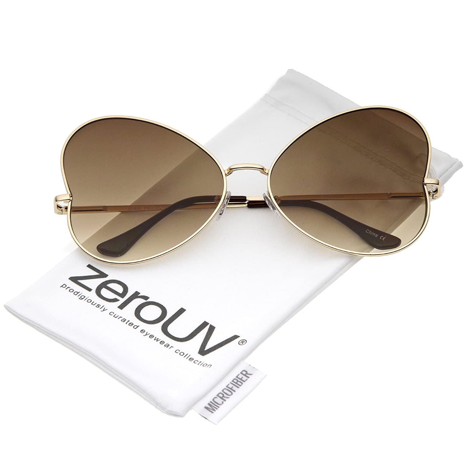 9c3dcef8ddc2 Amazon.com  zeroUV - Women s Oversize Ultra Slim Temple Gradient Flat Lens  Butterfly Sunglasses 61mm (Gold Brown Gradient)  Clothing