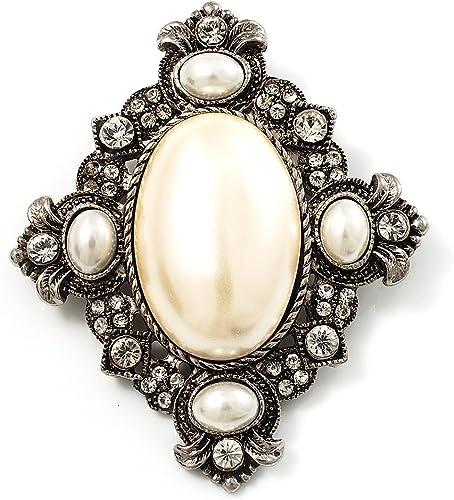 Broche vintage con perla ovalada