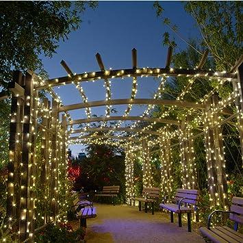 Qedertek Cadena de Luces 200 LED Solares Impermeables Luces de Navidad de 8 Modos para Decorar Hogar, Patio, Terraza, Fiesta, Boda, Cumpleaños,etc (Blanco cálido): Amazon.es: Hogar